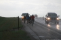 Riders approaching, in the rain