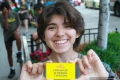 Sara (Argentina) holding our business card!